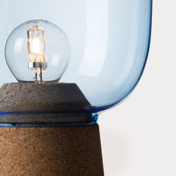 Picia table lamp designed by Enrico Zanolla in blue glass and natural cork, transparent cable, detail of the junction between cork and glass, beautiful match of curves