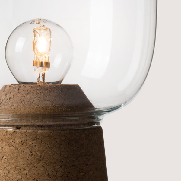 Picia table lamp designed by Enrico Zanolla in clear glass and natural cork, transparent cable, detail of the junction between cork and glass, beautiful match of curves