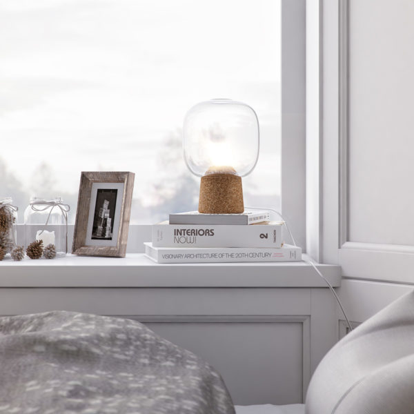 Picia table lamp designed by Enrico Zanolla in clear glass and natural cork near a window makes your room simply and neat