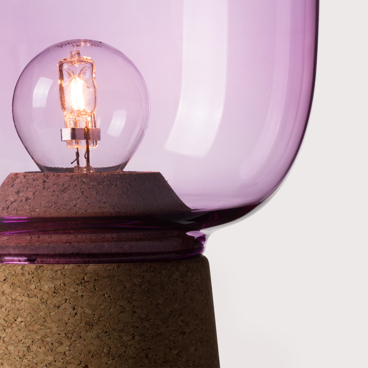 Picia table lamp designed by Enrico Zanolla in purple glass and natural cork, transparent cable, detail of the junction between cork and glass, beautiful match of curves