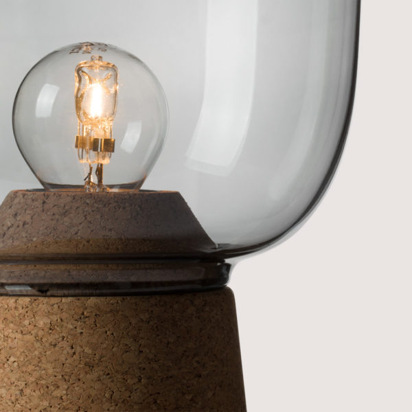Picia table lamp designed by Enrico Zanolla in smoked glass and natural cork, transparent cable, detail of the junction between cork and glass, beautiful match of curves