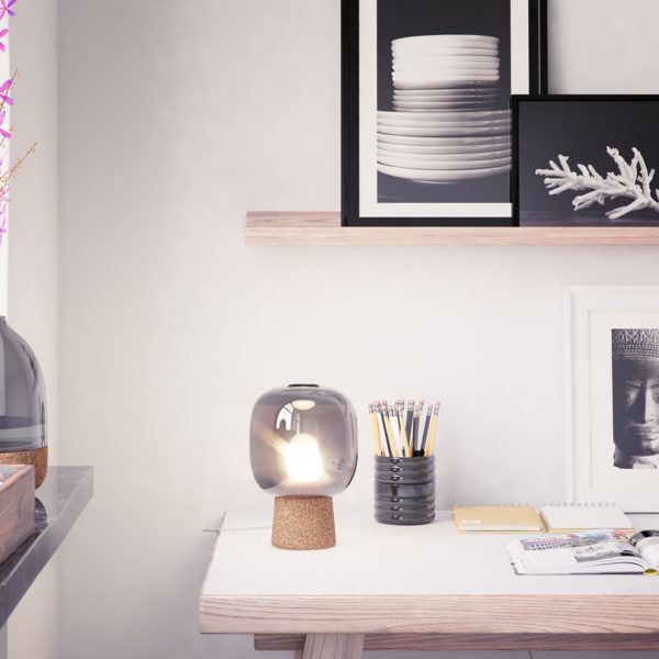 Picia table lamp designed by Enrico Zanolla in smoked glass and natural cork on a desk table, gives beautiful light to office space